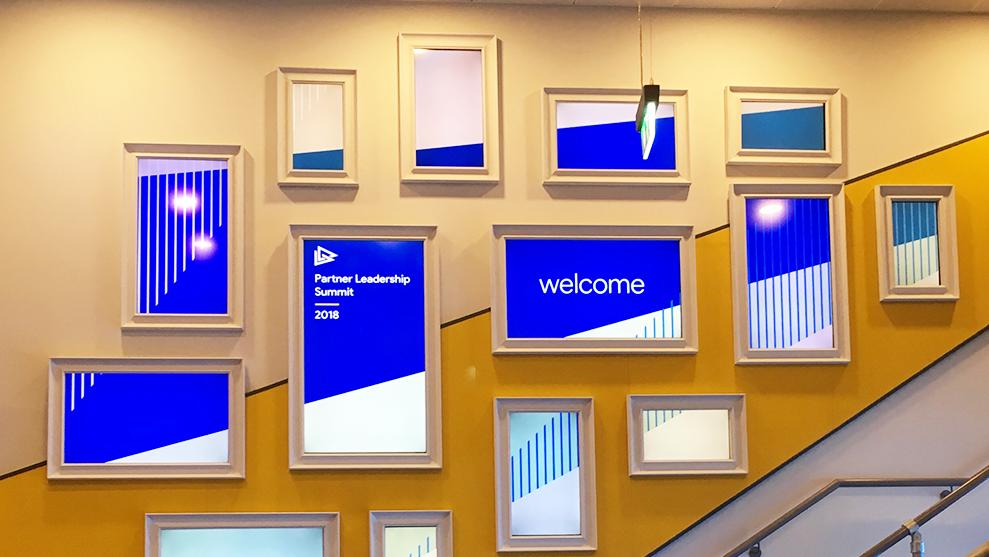 Digital screens welcoming guests